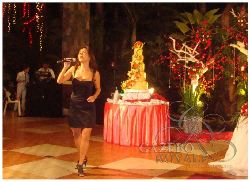 Ms Rachel Alejandro singing in a wedding event