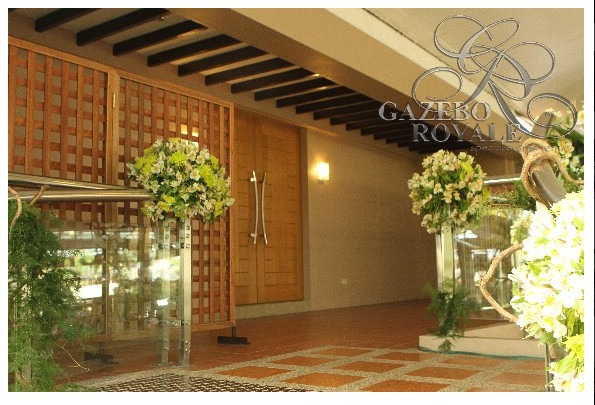 Wooden doors separate the balcony and the bridal suite